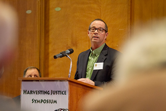 John Noble, a seventh-generation dairy farmer, speaks during a symposium on farmworker justice Oct. 29 at Temple B'rith Kodesh. As president of Noblehurst farms, Noble has employed people from more than 10 different countries in various positions.
