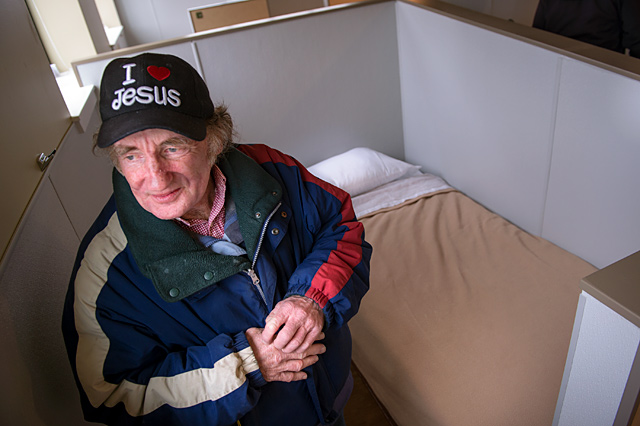 Rochester homeless resident Charlie Lemon looks out the window near his bed in the new location of the House of Mercy on Ormond Street in Rochester March 20.