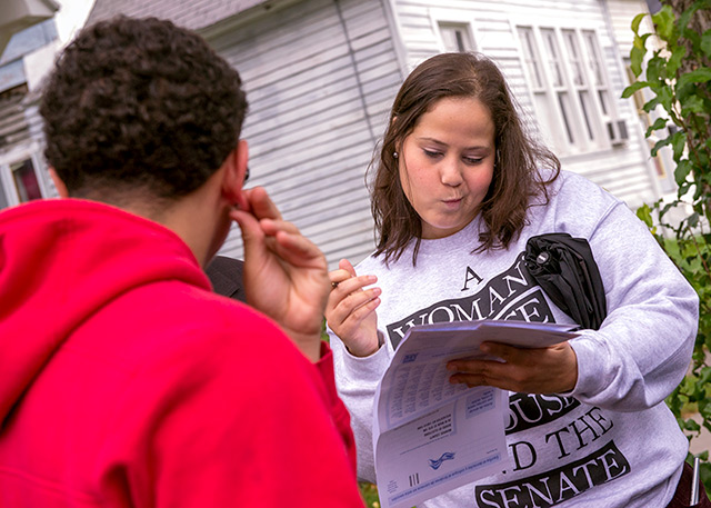 Jose Gonzalaz (left) is aided in filling out a voter registration form by Yversha Roman following a Latino Voter Fair and Engagement Rally Oct. 1, 2016.