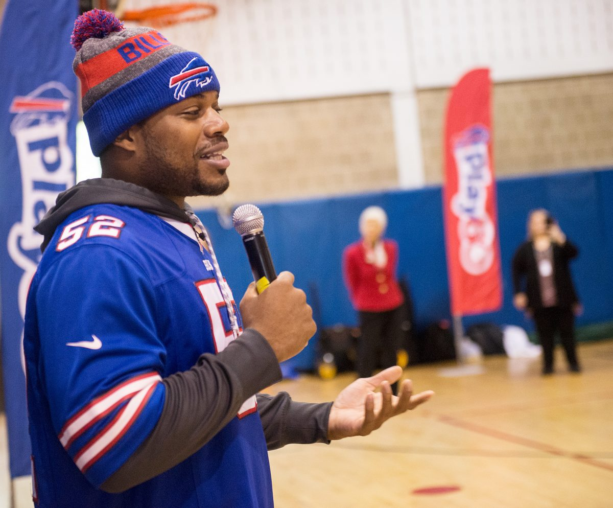 Buffalo Bills linebacker Preston Brown talks with fourth and fifth grade students at Nathaniel Rochester Community School #3 during a  Hometown Huddle event on Nov. 7. EMC Photo by John Haeger