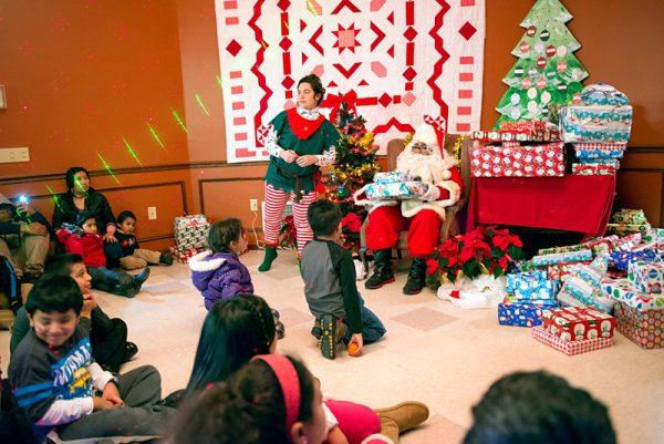 Santa Claus hands out gifts during a Christmas fiesta held Dec. 10 at The Center in Brockport. The event was sponsored by the Western New York Coalition of Farmworker Serving Agencies.