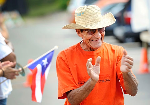 Eddie Rivero claps along to the music during Festival Latino.