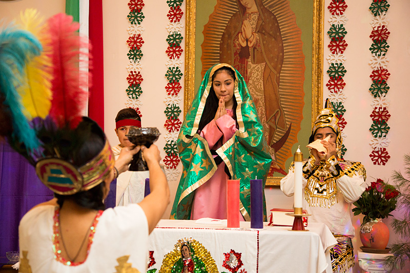 Sharon Jaramillo (back center) plays Our Lady of Guadalupe during a celebration at Guadalupe Mission Church in Marion. The celebration was in honor of Our Lady of Guadalupe, the patron saint of Mexico.