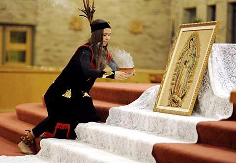 Natalie Hoppe places incense near a depiction of the Virgin.