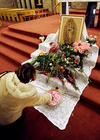 Flowers surround a depiction of Mary.