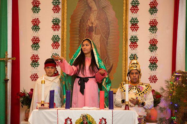 Sharon Jaramillo (center) performs as Our Lady of Guadalupe during the celebration. She is joined by Cesar Cruz (right) and Ricardo Arteaga (left).