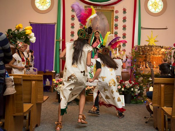 Naoni Rivera-Ronero (right) and Andrea Hurtado-Trejo (left) play indigenous women and perform a dance during the celebration.