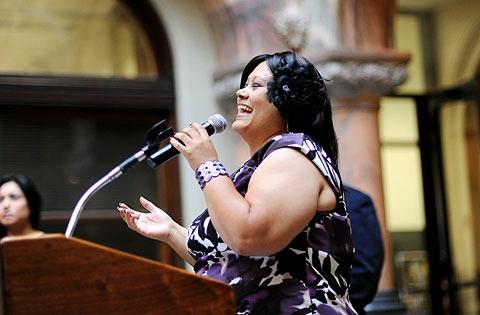 Raquel Serrano sings the Puerto Rican National Anthem.