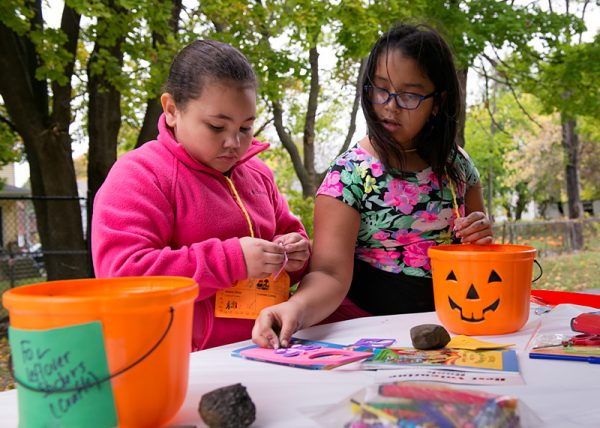 Nanette Lopez (left) and Lexany Marquez complete crafts during the festival.