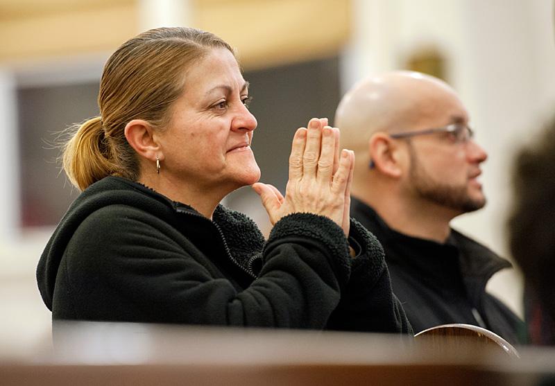 Gloria Rivera prays during the healing Mass.