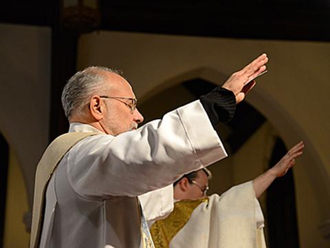 Fr. Tony Mugavero blesses the congregation.