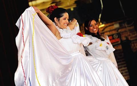 Erika Ramirez (L) and Evelyn Cassano with La Pollera Colora.