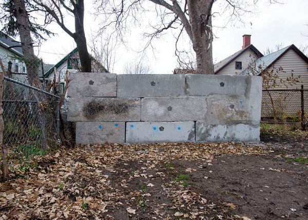 A wall erected by the city near Princeton Street aims to limit the foot traffic in areas where there is heavy heroin use.
