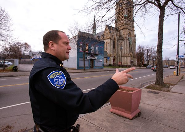 Rochester City Police Capt. Kevin Costello walks down North Clinton Avenue, an area that sees heavy heroin use.