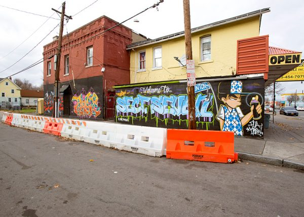 A barrier erected by the city aims to prevent cars from pulling over and interacting with drug dealers.