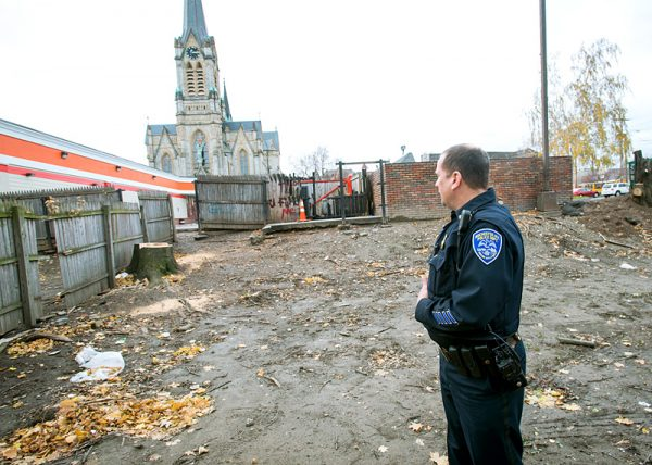 Rochester City Police Capt. Kevin Costello looks over one of the cleaned–up lots near North Clinton Avenue.