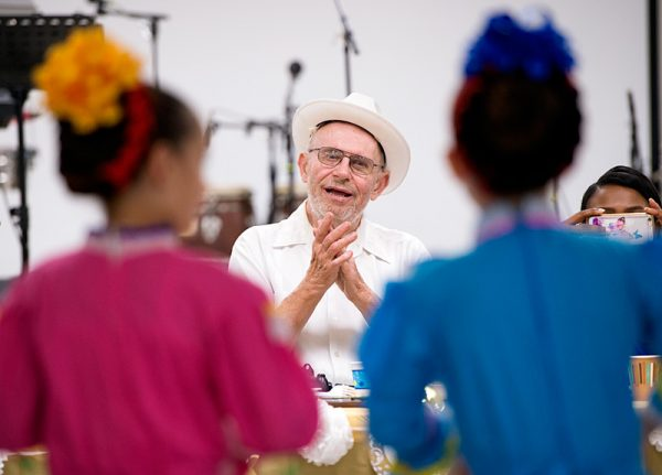 Father Laurence Tracy watches a dance performance during a gathering in his honor at Rochester's Our Lady of the Americas Church Oct. 7. , celebrating the 50th anniversary of his priest ordination.