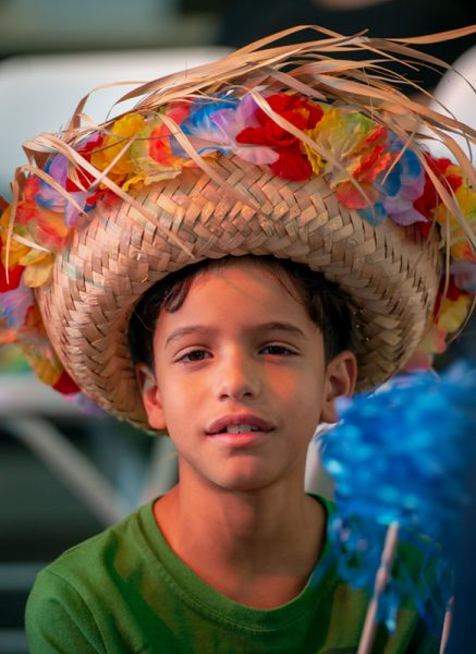 Eight-year-old Riano Rivera wears a straw hat during the Oct. 6 Hispanic Heritage Month event hosted by the Rochester Latino Theatre Company at The Avenue Blackbox Theatre.