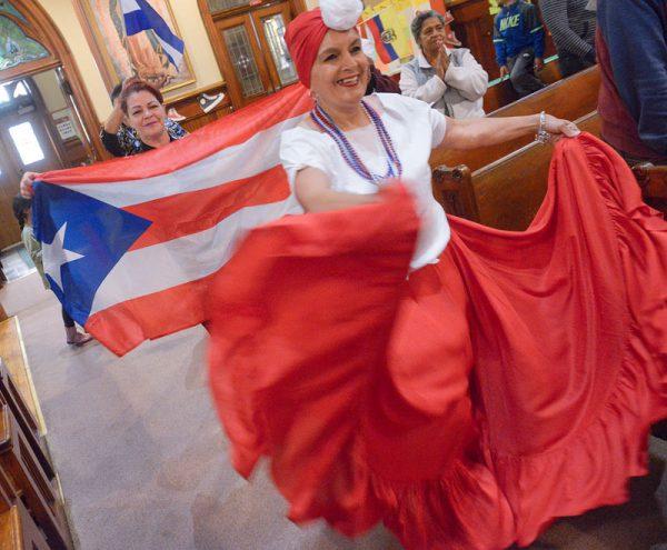 Migdalia Ruiz and Teresa Vega process into the Hispanic Heritage Month Mass at Rochester's Holy Apostles Church Sept. 30.