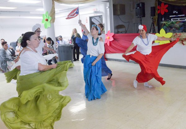 Dancers perform during a Sept. 30 Hispanic Heritage Month celebration in the parish hall at Holy Apostles Church.