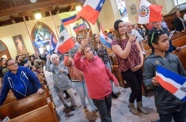 People process into the Hispanic Heritage Month Mass at Holy Apostles Church Sept. 30.