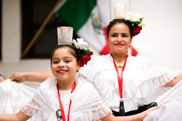 Nine-year-old Abril Ariza (left) and her mother, Laura Paez, dance during the celebration.