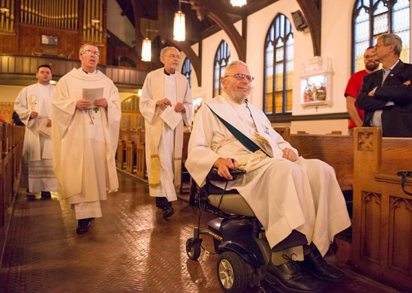 Father Laurence Tracy (right) processes into Mass, followed by Fathers Jorge Ramírez (from left) Mickey McGrath and Bob Werth.