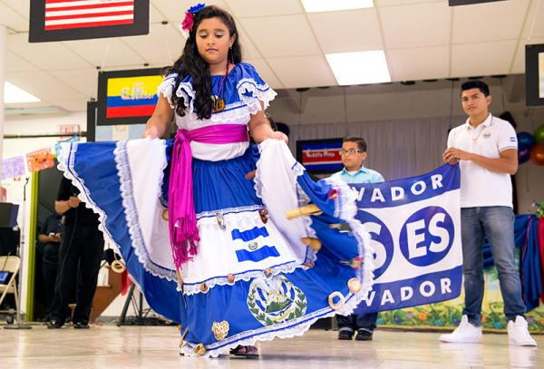 Nine-year-old Karla Martinez dances a traditional dance of El Salvador during the celebrations following Mass.