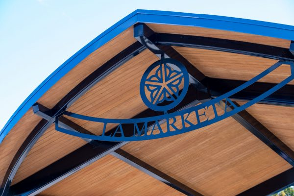 A sign for La Marketa hangs over the performance stage.