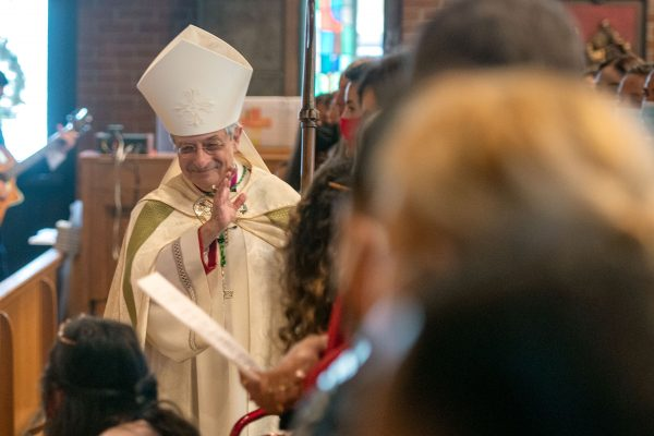 Bishop Salvatore R. Matano gives blessings as he processes into the church.