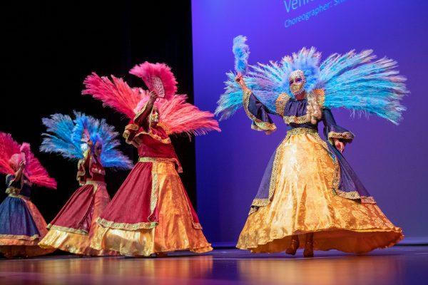 Costumed dancers onstage