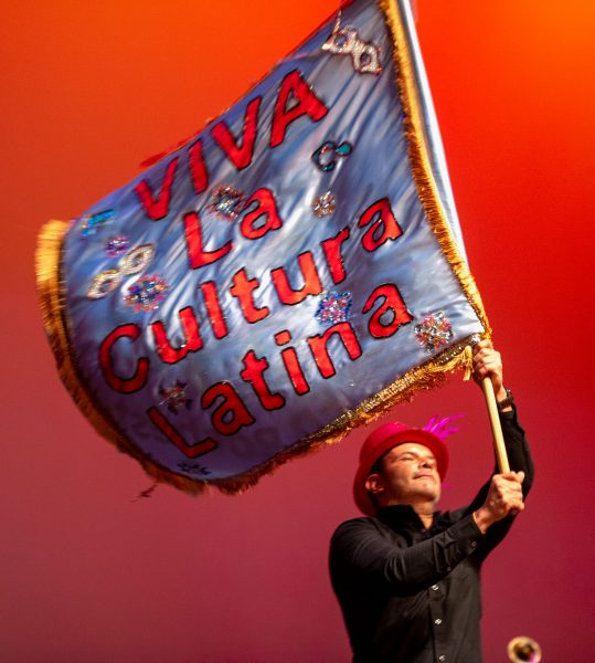A man waves a large flag.
