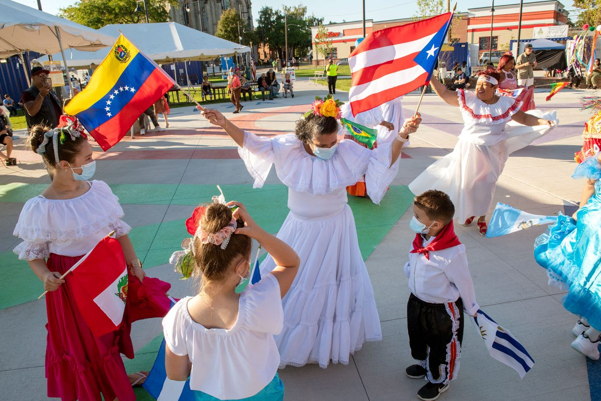 Grupo Cultural Latinos en Rochester dance to music by the Mambo Kings during a special Hispanic Heritage Month opening event at The International Plaza in Rochester Sept. 16.