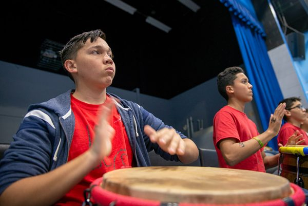 A boy plays the drums.