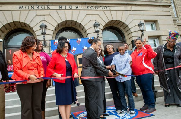 James Monroe High School students and staff, as well as Rochester City School District leaders, cut a ribbon to mark the reopening of the school during a ceremony Sept. 8.