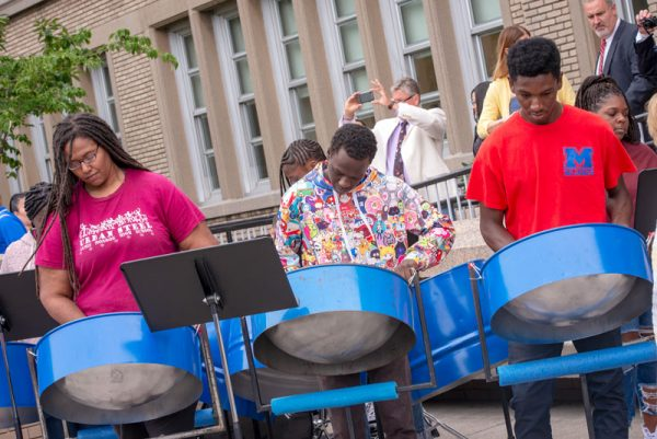 The school's steel drum band performs before the ceremony.
