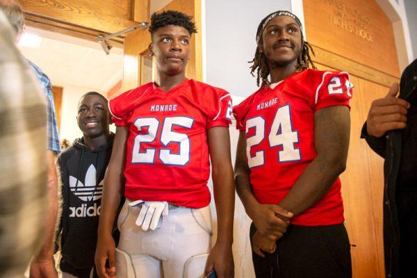 Monroe High School football players line up.
