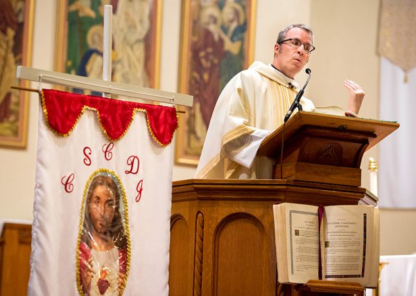 Father Mickey McGrath gives the homily during Mass.