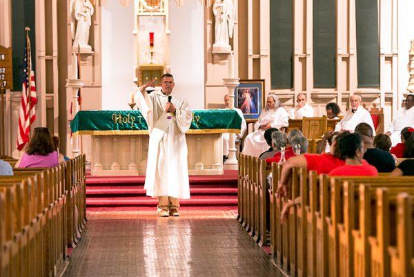 Deacon Salvador Otero gives the homily.