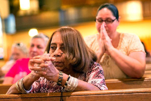 Carman Dorres prays during Mass.