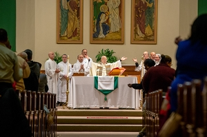 Father Anthony Mugavero celebrates the Liturgy of the Eucharist.