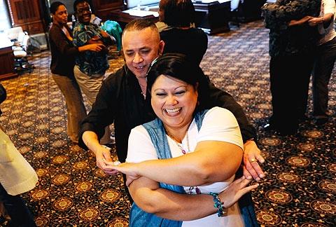Instructor Ruben Fuentes helps Raquel Serrano.