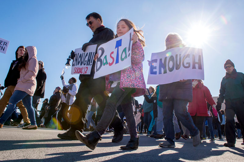 Elianna Renfrew (center) walks with Jim Renfrew (left) and Melissa Marquez (right) during the March for Our Lives protest March 24 in Rochester.