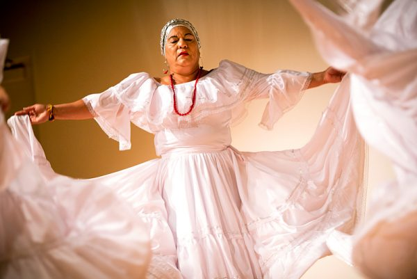 Luz Dary Delgado performs a traditional dance of Colombia during the annual Hispanic/Latino Heritage Family Day hosted by Rochester's Memorial Art Gallery Oct. 2.