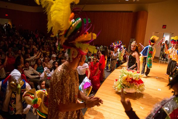 Performers take the stage at the end of the Colombian presentation in the auditorium.