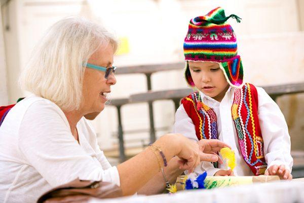Cheryl Melnick crafts a rainstick with her grandson, Sebastian Zitz.