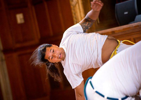 "David ""Xingu"" Caquias demonstrates the capoeira, a Brazilian martial art."