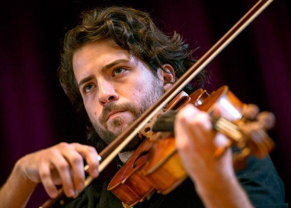 Alexander Peña plays the viola in the M&T Bank Ballroom.