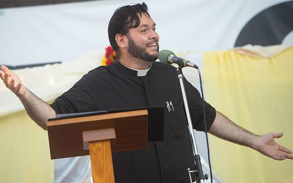 ather Jorge Ramirez preaches Aug. 5 during the opening night of the annual Santa Mision at Holy Apostles Church in Rochester.