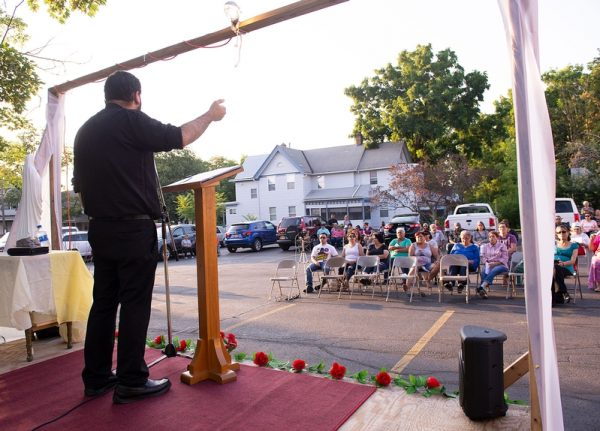 Participants listen as Father Jorge Ramirez preaches.